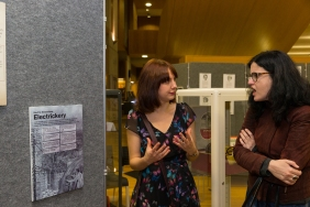 Dr Ceri Houlbrook discussing the 'Fear' section of the exhibition with one of the guests.