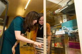 Guests browsing the display cabinets that showcase an array of electrical items from across the 20th century
